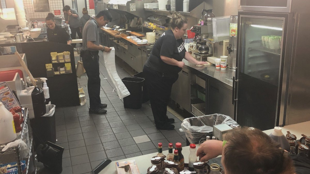 Struggling, short-staffed Waffle House crew gets help from tired officers