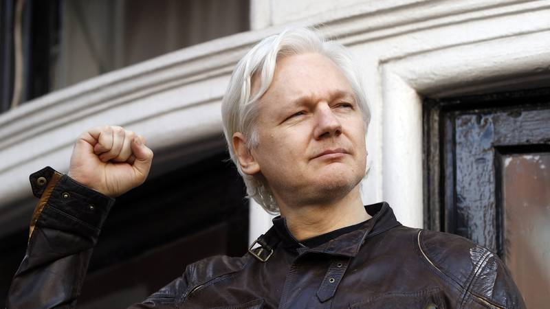 FILE - In this Friday, May 19, 2017 file photo, Julian Assange greets supporters outside the...