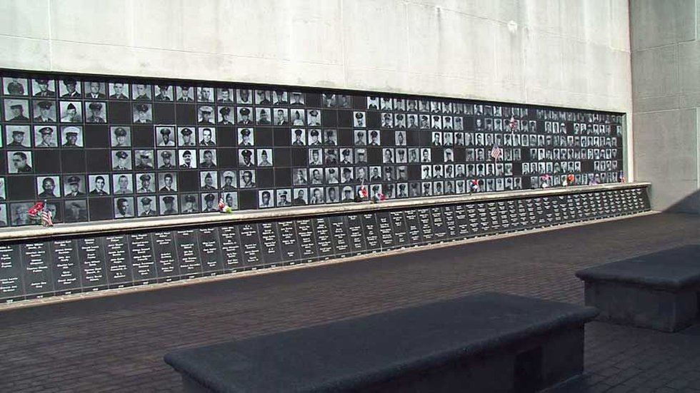 The memorial is constructed within two huge concrete walls, on black granite. Listed are the...