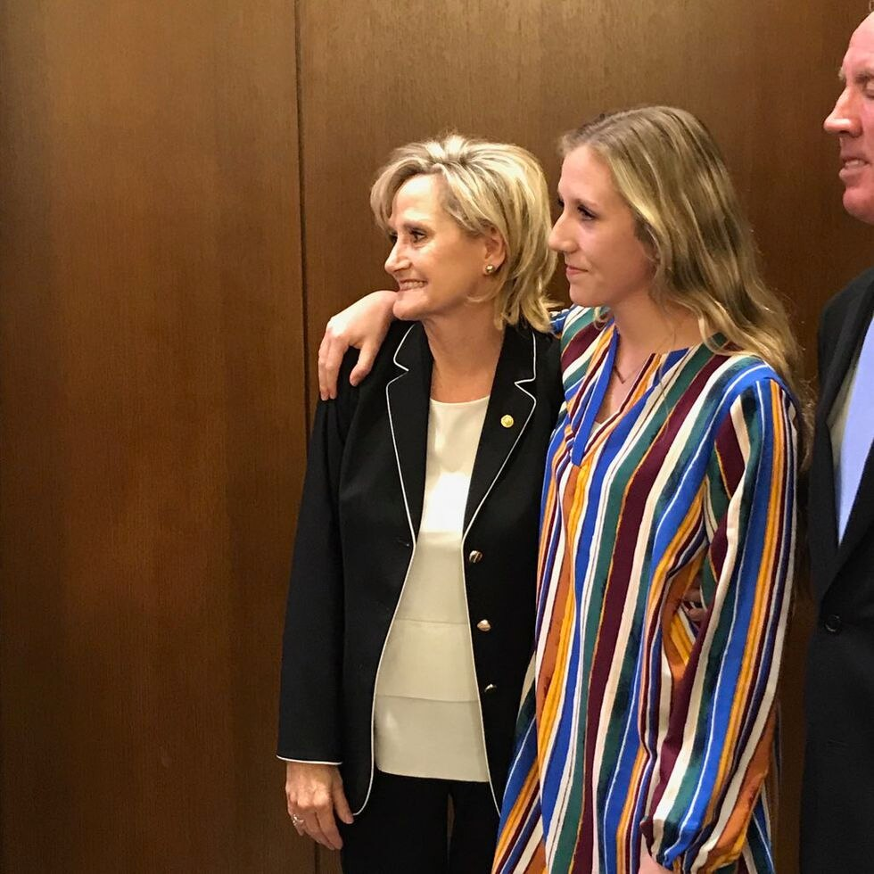 Cindy Hyde-Smith and family take a moment during victory party. Source: Laurie McCarthy