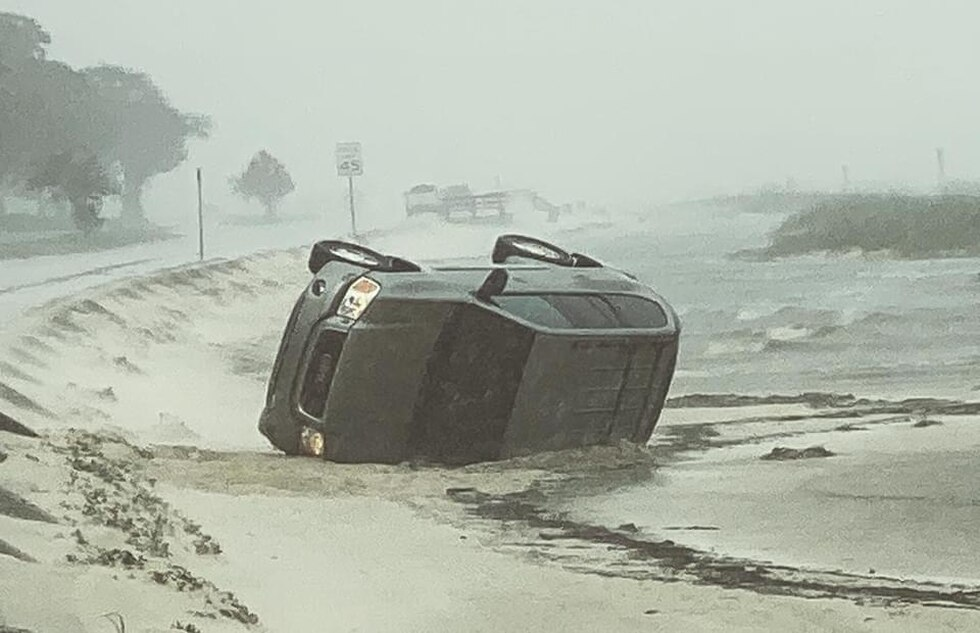 An SUV flipped onto the sand beach from Highway 90 in Pass Christian between Davis and Fleitas...