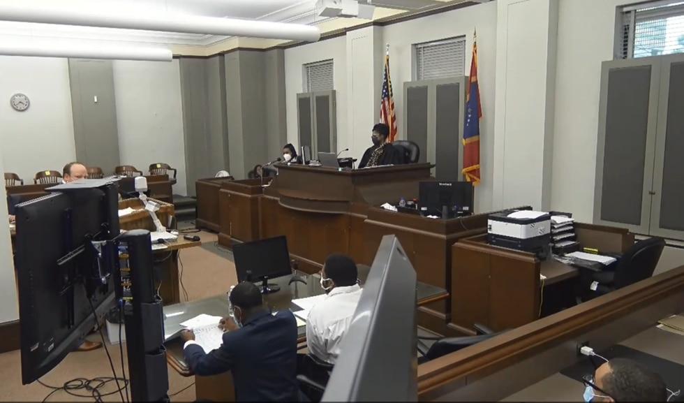 A defense attorney questions a crime scene investigator during the Gino Washington trial.