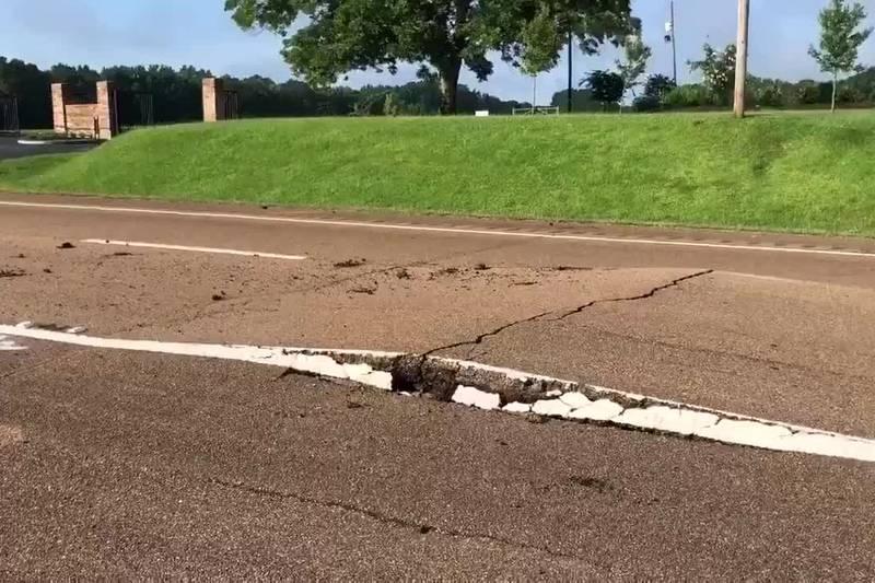 Asphalt buckles Highway 49 near Flora, left lane closed