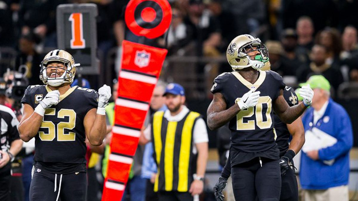 Saints defenders Craig Robertson and Ken Crawley on the field during a Saints home game...