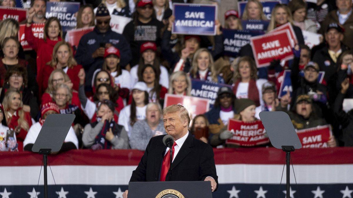 President Donald Trump addresses the crowd at a rally for U.S. Senators Kelly Loeffler, R-Ga.,...