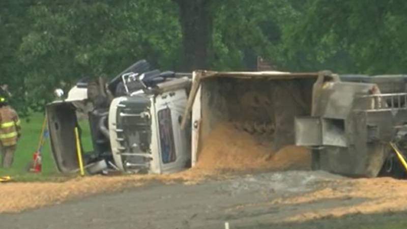 A dump truck full of sand overturned on the Natchez Trace entrance ramp from I-55 South in...