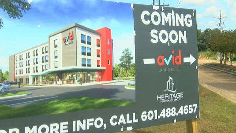 Sign at the site of a proposed Avid hotel in Pearl (Source: WLBT)