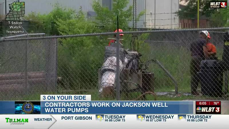 Contractors work to replace malfunctioning water well pumps