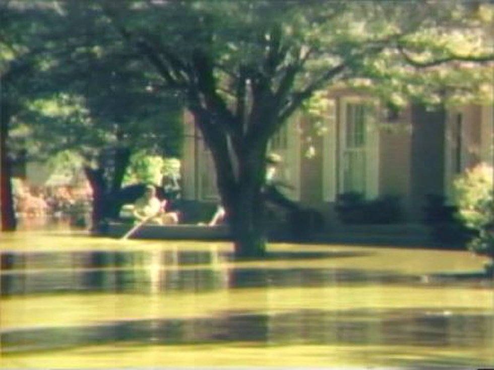 Jackson residents reach their home by boat in the Easter Flood of 1979 (Source: WLBT)