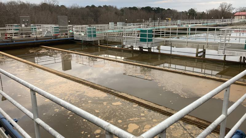 Water is allowed to settle at the Curtis plant's coventional basin, before it is chemically...