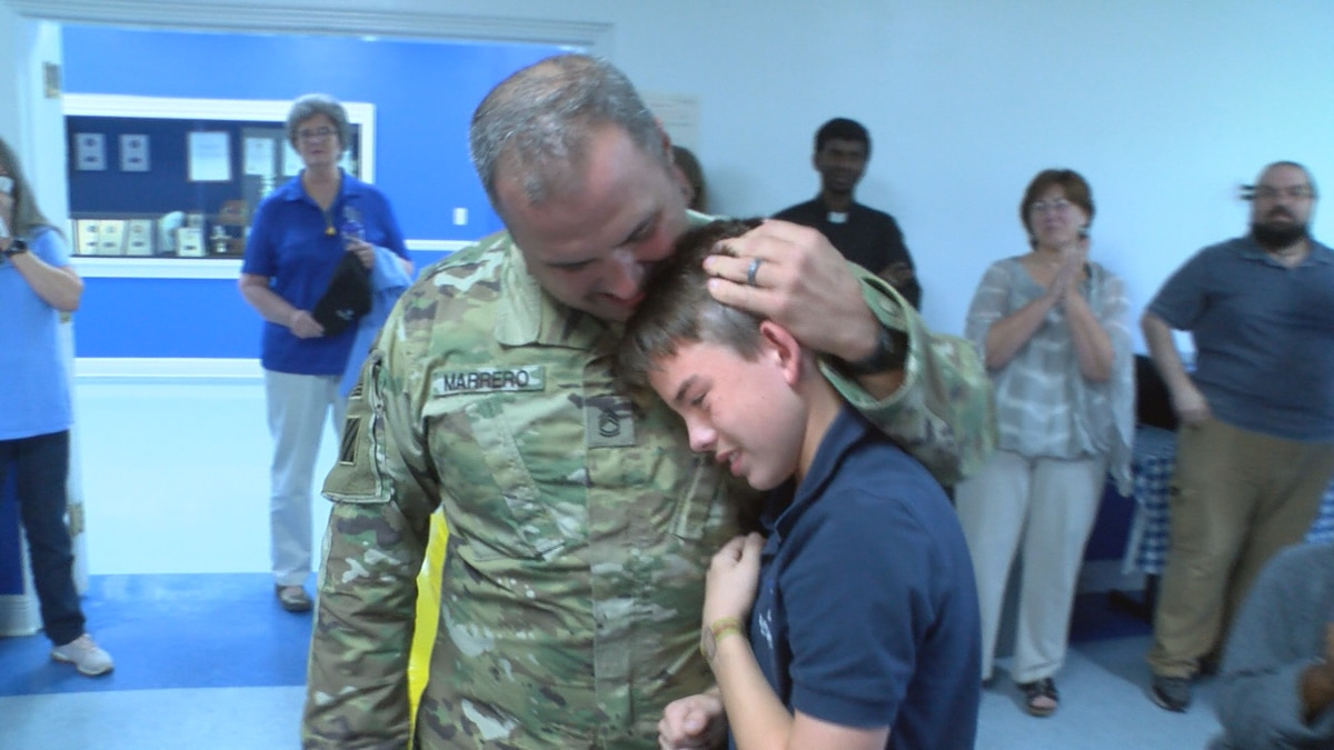 Sergeant First Class Brad Marrero surprises his son, Brad Marrero, Jr., with a visit at Sacred...