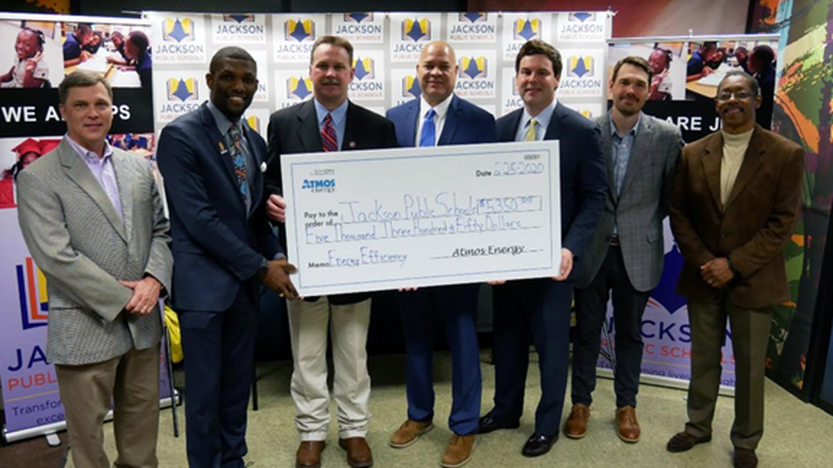 Atmos Energy and PSC Commissioner Brent Bailey present $5,350 check to Jackson Public Schools