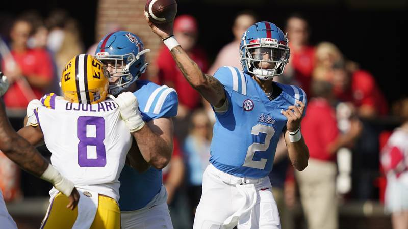 Mississippi quarterback Matt Corral (2) throws a pass against LSU in the first half of an NCAA...