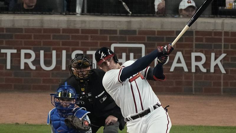 Atlanta Braves' Austin Riley watches his home run in the fourth inning in Game 1 of baseball's...