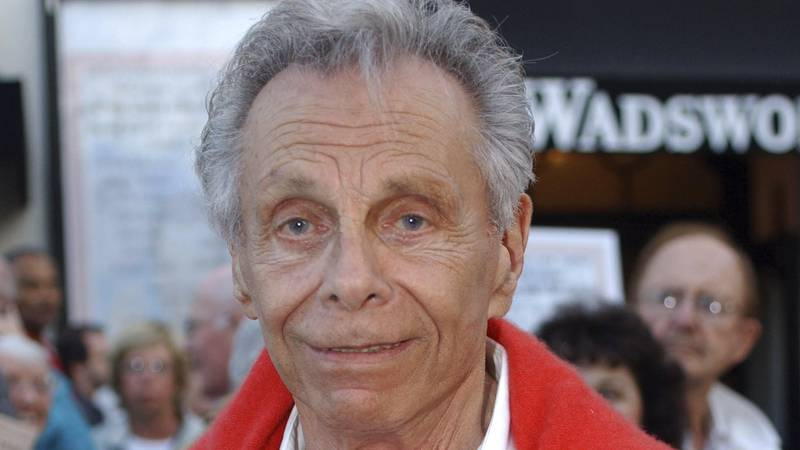 """Comedian Mort Sahl poses for photographs at the 80th Birthday """"Sahl-ute"""" honoring him, in Los..."""