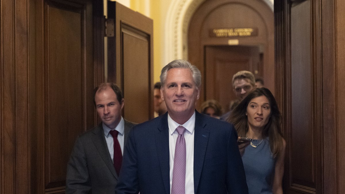 House Minority Leader Kevin McCarthy of Calif., center, leaves the floor after the House voted...