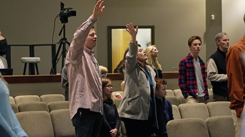 Congregants sing along with the choir at Highland Colony Baptist Church in Ridgeland, Miss.,...