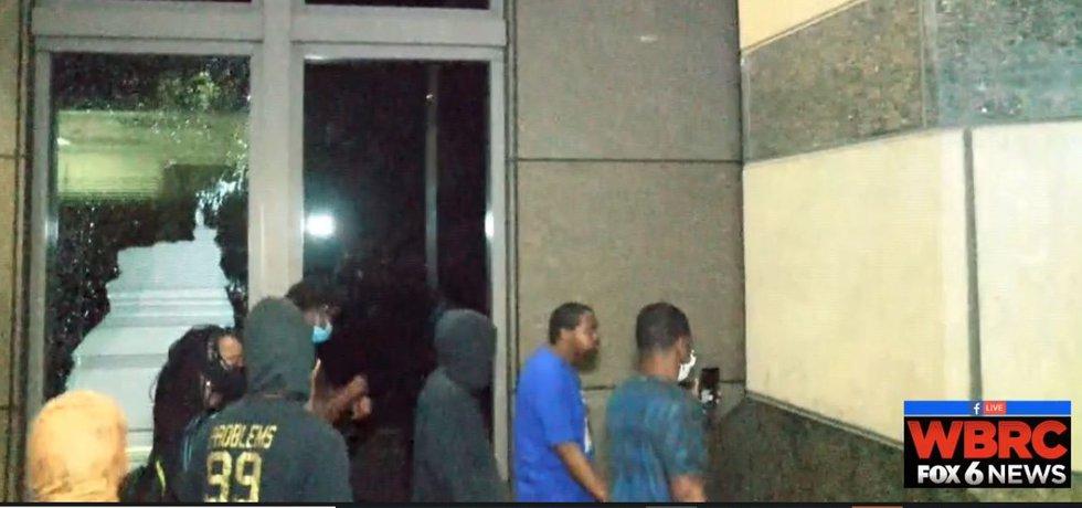 Protesters smash windows at Wells Fargo building in Birmingham