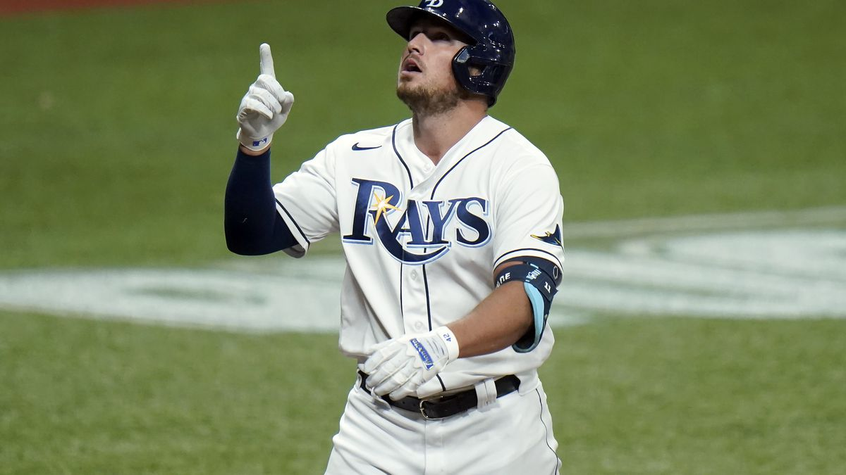 Tampa Bay Rays' Hunter Renfroe celebrates his solo home run off Boston Red Sox pitcher Mike...