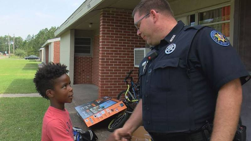 Nine-year-old Lamonte Brown thanks Harrison County Sheriff's Deputy Joshua Macko for getting...