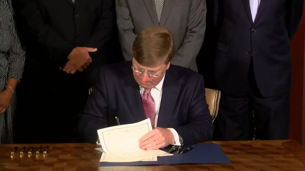 Mississippi governor signs bill changing state flag