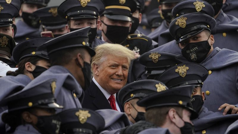 Surrounded by Army cadets, President Donald Trump watches the 121st Army-Navy Football Game in...