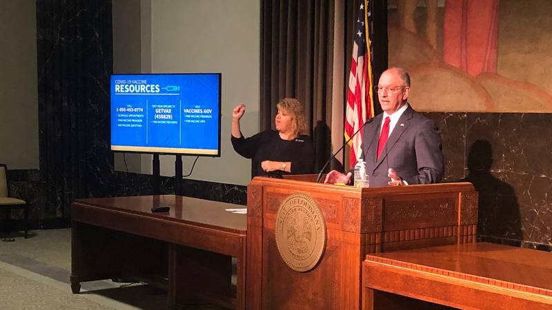 FILE - Gov. John Bel Edwards holds news conference on Louisiana's response to COVID-19 at the...