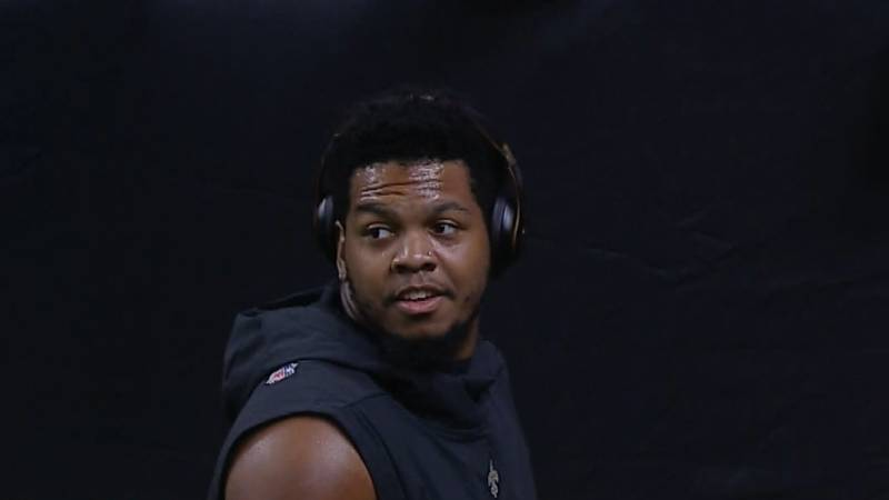 Marcus Davenport takes a break from signing autographs to survey the Superdome field before a...
