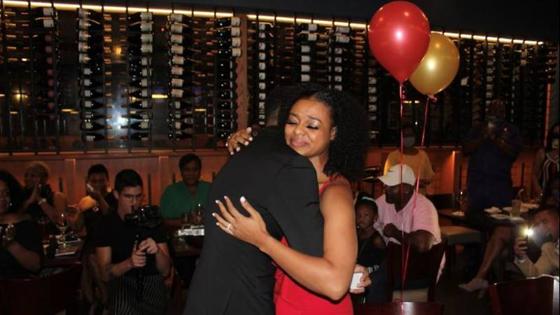 Kayla McKinney and her fiance', James Jourdan, embrace after his surprise marriage proposal....