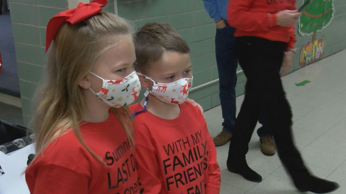 Five-year-old Sumner Holland, left, celebrates his last day of chemotherapy for leukemia with...