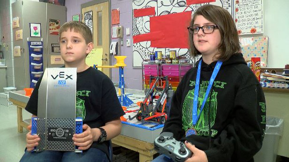 Ethan Knight and Kinsley Poole with the award their team won at the VEX Robotics World...