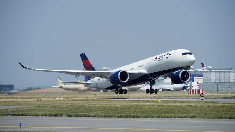 Delta passengers and crew subdue an off-duty flight attendant on an Atlanta-bound flight.