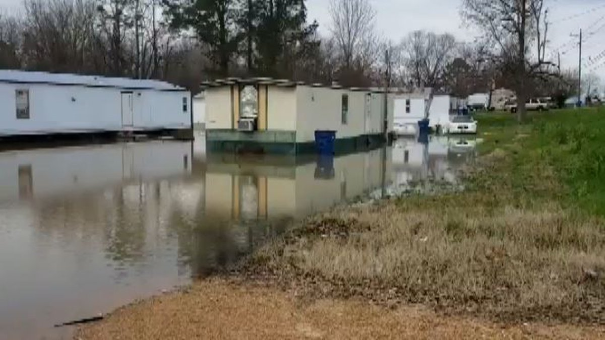 Homes flooding due to rising lake.