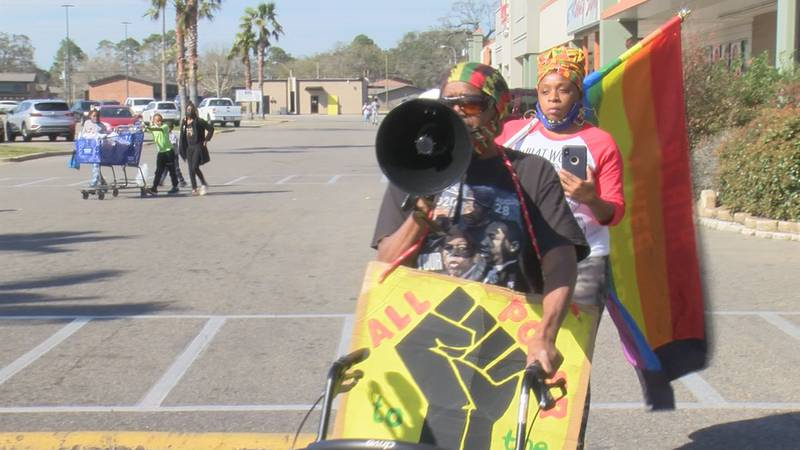 The protest was held after a couple alleged that racial slurs were made toward them while they...