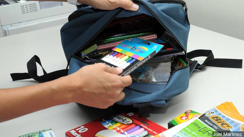 Volunteers filled backpacks with school supplies for kindergartners through fifth-graders at...