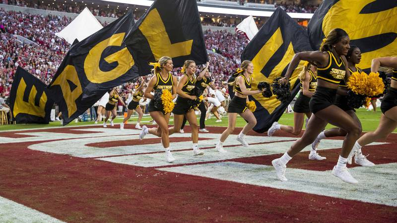 Southern Mississippi takes the field during the first half of an NCAA college football game...