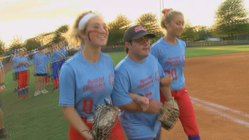 Special Olympians as far as Vicksburg game to show their talent off on the mound.  Both...