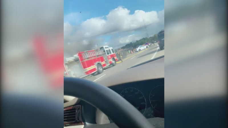 Car on fire and backing up traffic in Jackson.