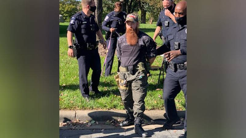An armed man was arrested at a polling site in north Charlotte after police say he was banned...
