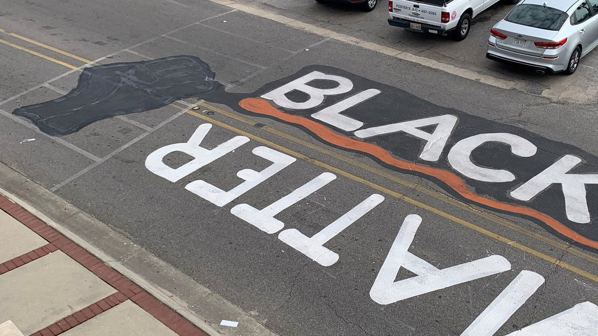 Tony Loper took to downtown Moss Point Wednesday morning to paint over the raised black fist...