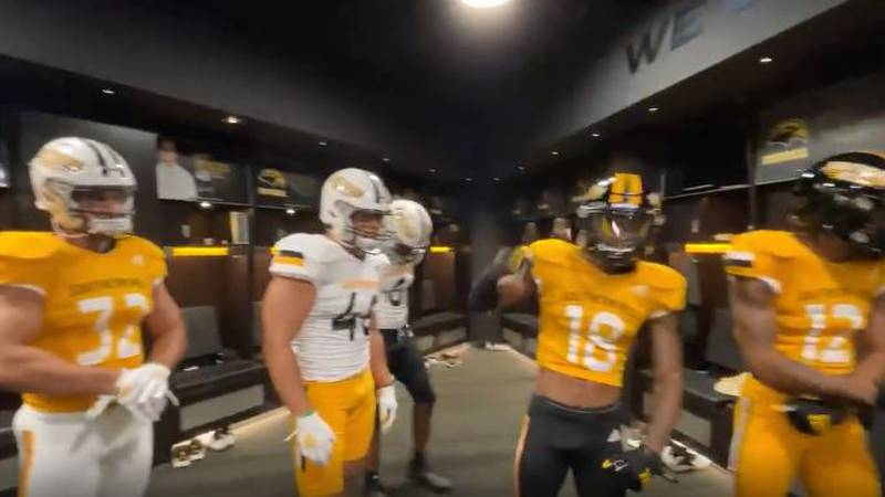 Players show off new football uniforms for the 2021 season.