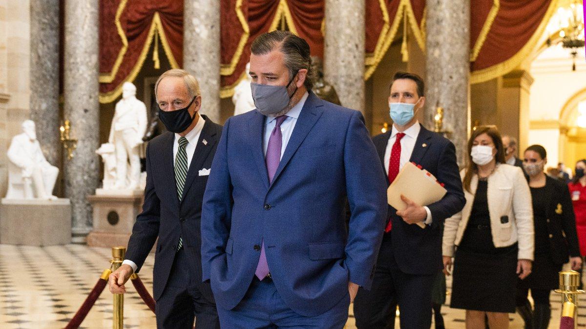 Sen. Ted Cruz, R-Texas, front, followed by Sen. Josh Hawley, R-Mo., walk from the House Chamber...