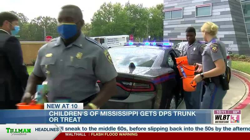 Troopers hand out Halloween candy at Children's of Mississippi