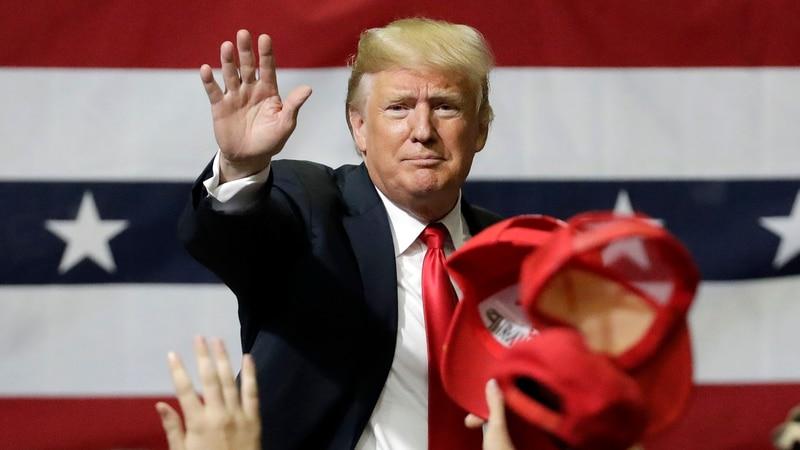 President Donald Trump acknowledges the crowd as he leaves a rally Sunday, Nov. 4, 2018, in...