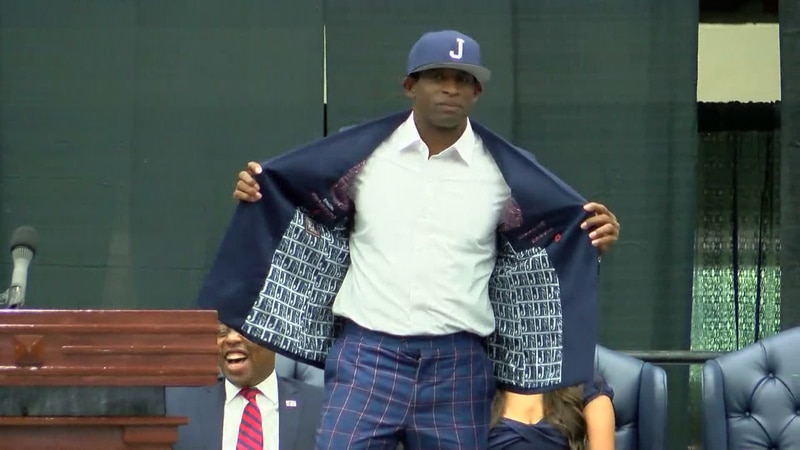 Deion Sanders shows off his new look as Jackson State's head football coach.