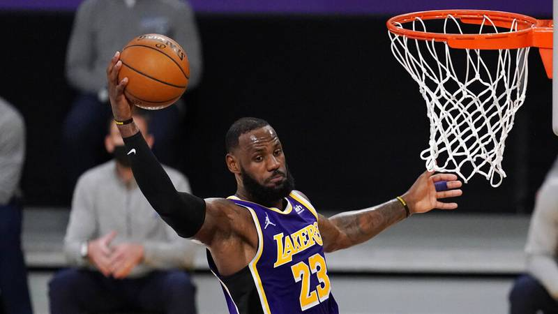 Los Angeles Lakers forward LeBron James grabs a rebound during an NBA basketball game against...