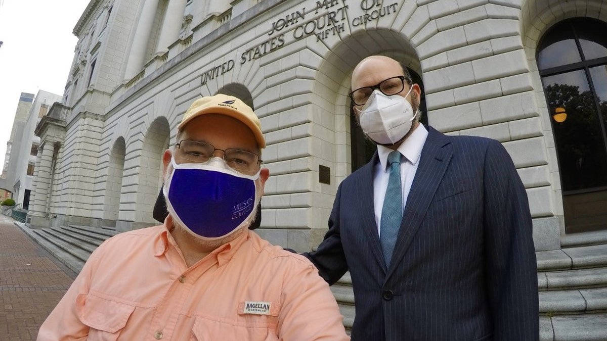 Scott Crawford and attorney Andrew Bizer pose for a self portrait outside the U.S. Federal...