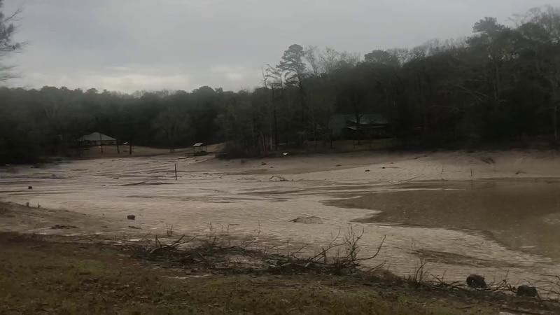 The dam failed, causing the fishing lake to drain.