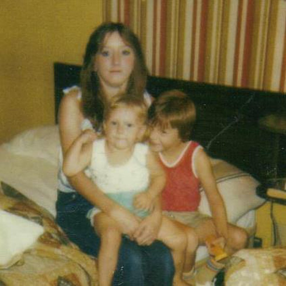 Linda Price, seen here holding her young daughter, is seated beside her son in this undated...