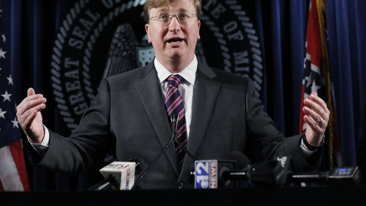 Republican Gov. Tate Reeves reacts to a question during a news conference regarding his...